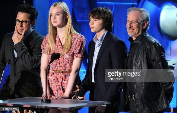 Writer/director JJ Abrams actors Elle Fanning and Joel Courtney and director Steven Spielberg speak onstage during the 2011 MTV Movie Awards at...