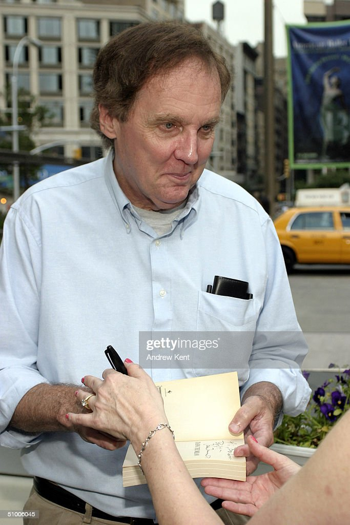 Writer/Director John Mulholland signs autographs outside before MODA Entertainment's Tribute Screening Of 'Pride Of The Yankees' at Lincoln Center on June 28, 2004 in New York City.