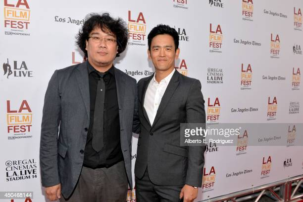 Writer/director Joonho Bong and actor John Cho attend the opening night premiere of Snowpiercer during the 2014 Los Angeles Film Festival at Regal...