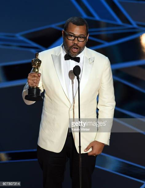 Writer/director Jordan Peele accepts Best Original Screenplay for 'Get Out' onstage during the 90th Annual Academy Awards at the Dolby Theatre at...