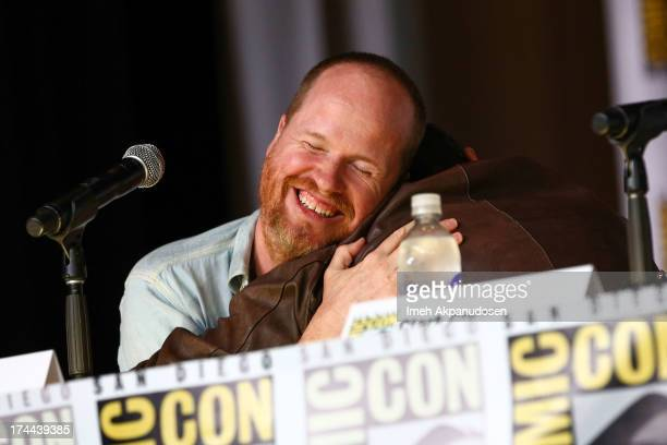 Writer/director Joss Whedon and actor Clark Gregg attend the 'Marvel's Agents of SHIELD On ABC' panel during ComicCon International 2013 at San Diego...