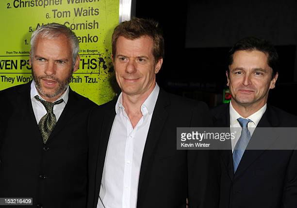 Writer/director Martin McDonagh producers Graham Broadbent and Peter Czernin arrive at the premiere of CBS Films' 'Seven Psychopaths' at Mann Bruin...