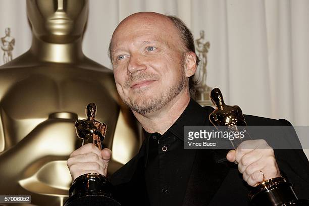 Writer/Director Paul Haggis walks backstage with his Oscar Statuettes for Best Original Screenplay and Best Motion Picture of the Year for the film...