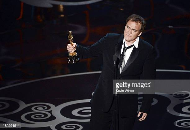 Writer/director Quentin Tarantino accepts the Best Writing Original Screenplay award for 'Django Unchained' onstage during the Oscars held at the...