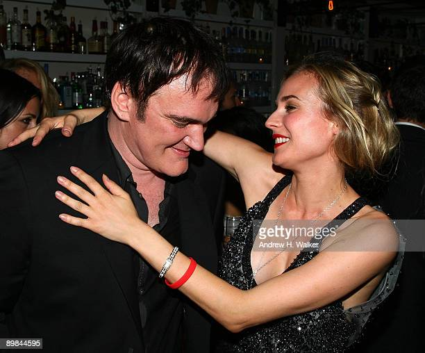 Writer/director Quentin Tarantino speaks with actress Diane Kruger during the after party for The Cinema Society Hugo Boss screening of Inglourious...