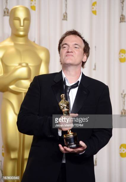 """Writer-director Quentin Tarantino, winner of the Best Original Screenplay award for """"Django Unchained,"""" poses in the press room during the Oscars..."""