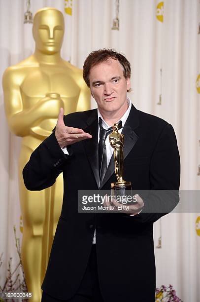Writerdirector Quentin Tarantino winner of the Best Original Screenplay award for Django Unchained poses in the press room during the Oscars held at...