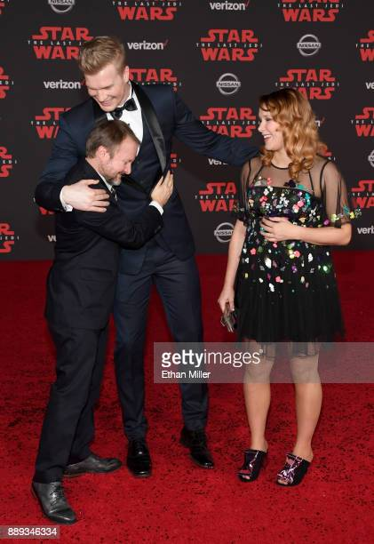 Writer/director Rian Johnson actor and Finnish basketball player Joonas Suotamo and Milla Pohjasvaara attend the premiere of Disney Pictures and...