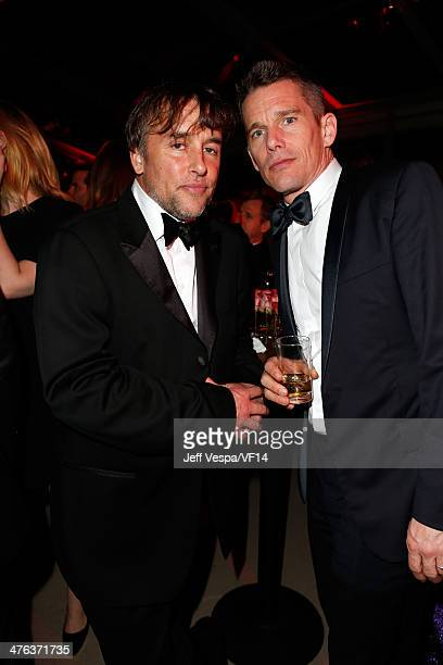 Writer/director Richard Linklater and writer/actor Ethan Hawke attend the 2014 Vanity Fair Oscar Party Hosted By Graydon Carter on March 2 2014 in...