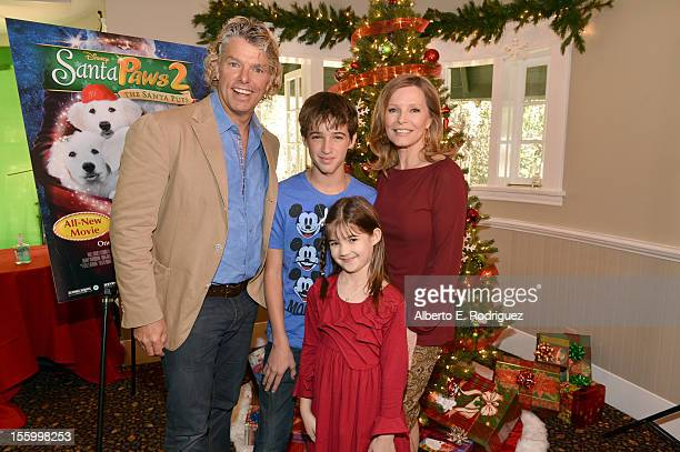 Writer/director Robert Vince actors Josh Feldman Kaitlyn Maher and Cheryl Ladd attend the 'Santa Paws 2 The Santa Pups' holiday party hosted by...