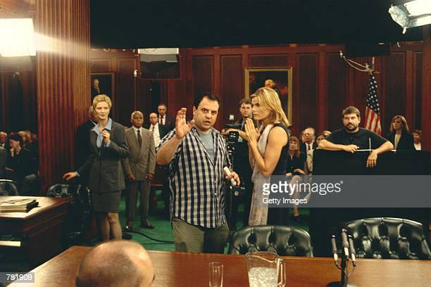 Writer/director Rod Lurie left goes over a scene with Mariel Hemingway right as Joan Allen far left looks on during the filming of DreamWorks...
