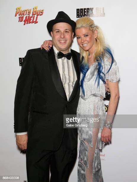 Writer/director Rolfe Kanefsky and actress Tara Reid attend the premiere of 'Party Bus to Hell' at AMC Town Square 18 theatres on October 30 2017 in...
