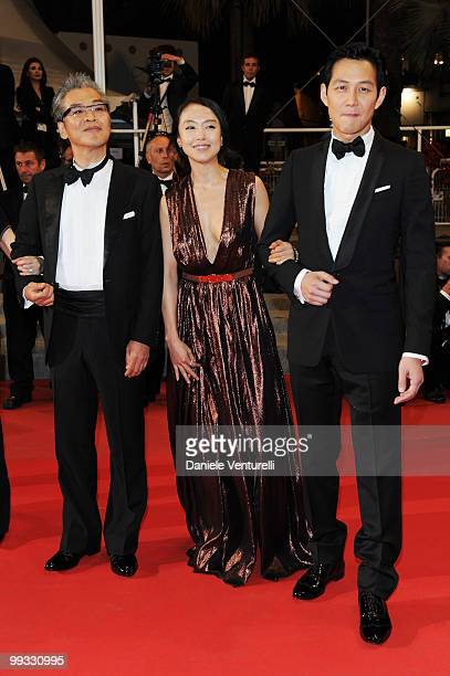 Writer/director SangSoo Im actress Doyeon Jeon and actor JungJae Lee attend attends the Premiere of 'The Housemaid' held at the Palais des Festivals...