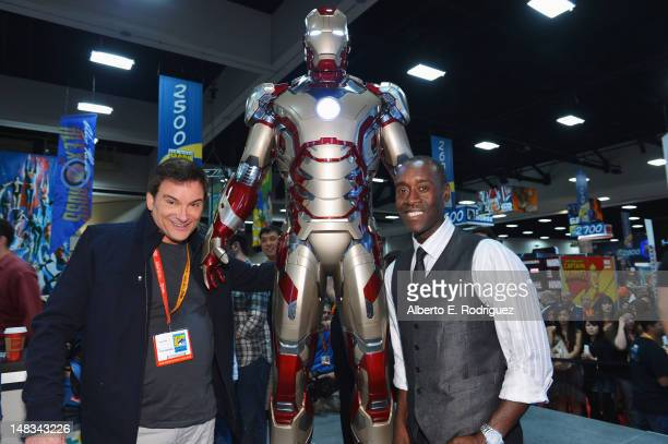 Writer/director Shane Black and actor Don Cheadle pose with Marvel Studios during Comic-Con International 2012 at San Diego Convention Center on July...