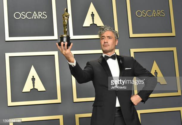 Writerdirector Taika Waititi winner of the Adapted Screenplay award for Jojo Rabbit poses in the press room during the 92nd Annual Academy Awards at...