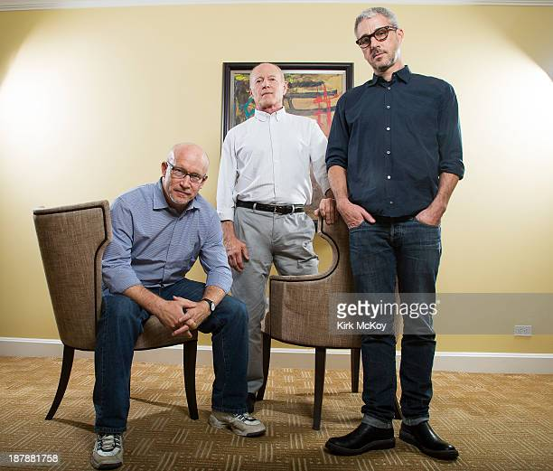 Writer/director/producer Alex Gibney and producers Matt Tolmach and Frank Marshall are photographed for Los Angeles Times on October 24 2013 in...