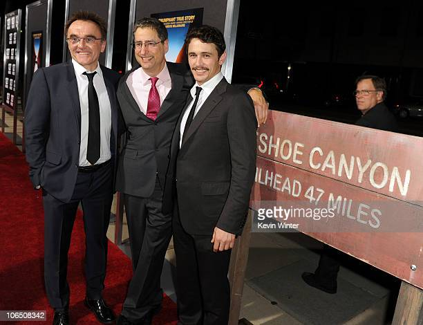 Writer/director/producer Danny Boyle CoChairman and CEO FOX Filmed Entertainment Tom Rothman and actor James Franco arrive at the premiere of Fox...