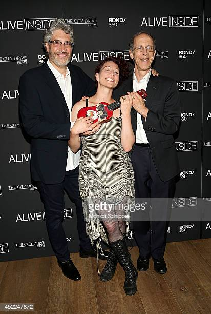 Writer/director/producer Michael RossatoBennett singer Amanda Palmer and Dan Cohen attend the Alive Inside premiere at Crosby Street Hotel on July 16...