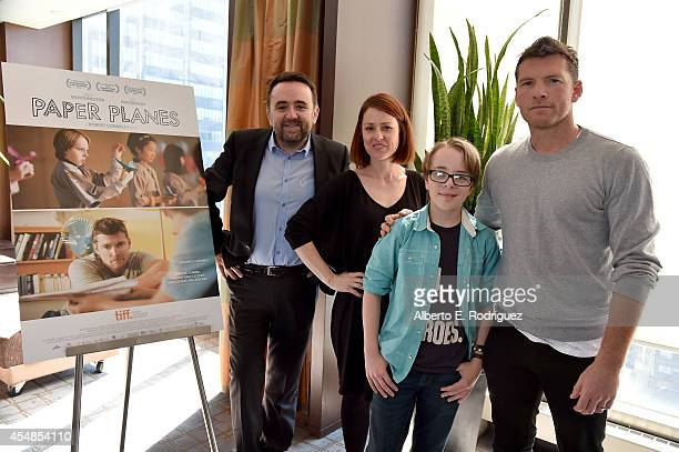 Writer/Director/Producer Robert Connolly Producer Liz Kearney actors Ed Oxenbould and Sam Worthington attend the 'Paper Planes' photo call during the...