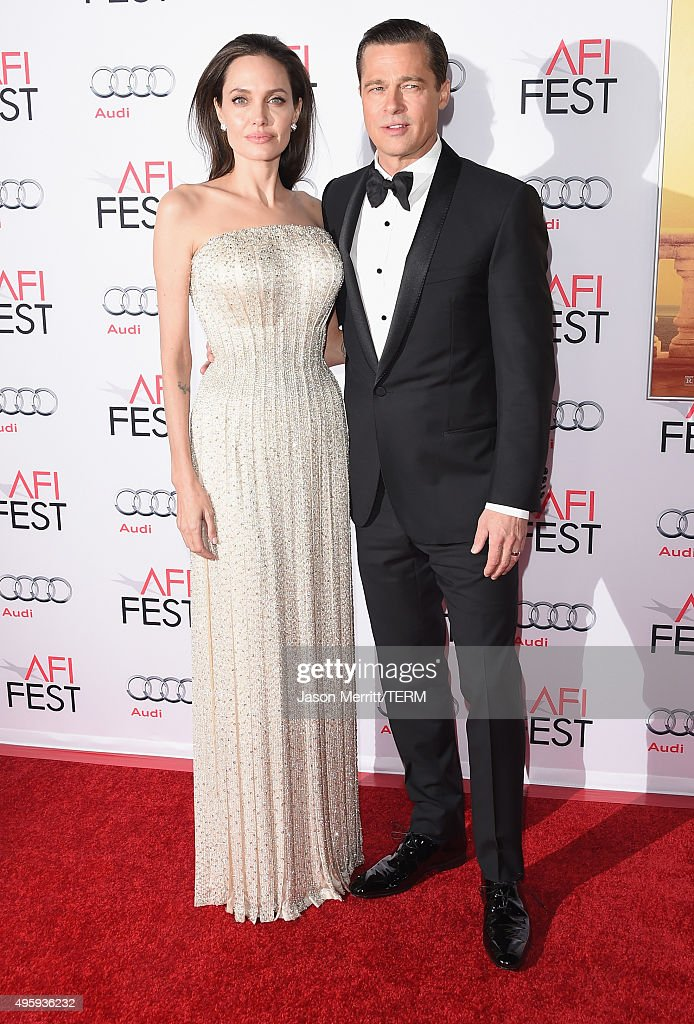 Writer-director-producer-actress Angelina Jolie Pitt (L) and actor-producer Brad Pitt attend the opening night gala premiere of Universal Pictures' 'By the Sea' during AFI FEST 2015 presented by Audi at TCL Chinese 6 Theatres on November 5, 2015 in Hollywood, California.