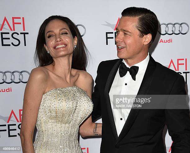Writerdirectorproduceractress Angelina Jolie Pitt and actorproducer Brad Pitt arrive for the opening night gala premiere of Universal Pictures' 'By...