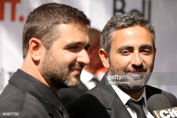 Writer/directors Olivier Nakache and Eric Toledano attend the 'Samba' premiere during the 2014 Toronto International Film Festival at Roy Thomson...