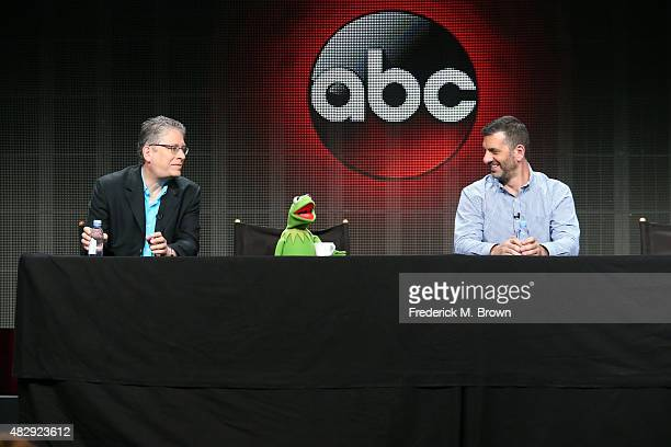 Writer/executive producer Bill Prady Kermit the Frog and writer/executive producer Bob Kushell speak onstage during the 'The Muppets' panel...