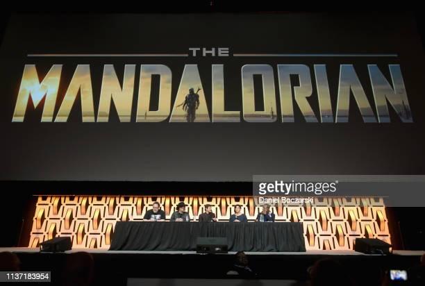 "Writer/executive producer Jon Favreau, Director/executive producer Dave Filoni, Pedro Pascal , Gina Carano and Carl Weathers onstage during ""The..."