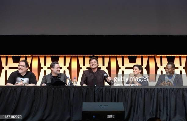 Writer/executive producer Jon Favreau Director/executive producer Dave Filoni Pedro Pascal Gina Carano and Carl Weathers onstage during The...