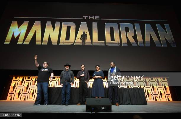 Writer/executive producer Jon Favreau Director/executive producer Dave Filoni Pedro Pascal Gina Carano and Carl Weathers onstage during The...