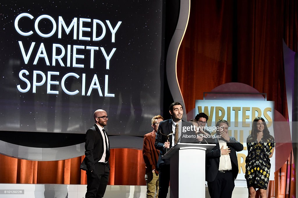 WriterJeff Loveness (speaking at lectern) and fellow writers accept the Comedy/Variety Specials award for 'Jimmy Kimmel Live: 10th Annual After The Oscars Special' onstage during the 2016 Writers Guild Awards at the Hyatt Regency Century Plaza on February 13, 2016 in Los Angeles, California.
