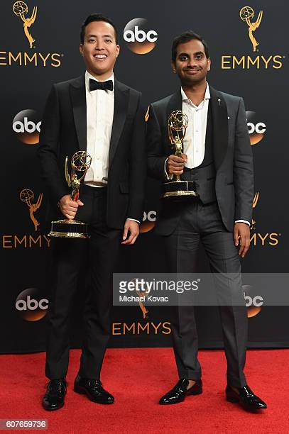 Writer-producer Alan Yang and actor-comedian Aziz Ansari, winners of Best Writing for a Comedy Series for 'Master of None', pose in the press room at...