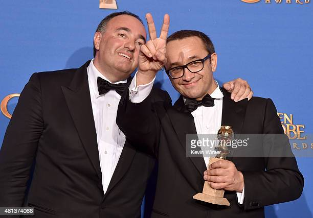 Writer/producer Alexander Rodnyansky and director Andrey Zvyagintsev winners of Best Foreign Language Film for 'Leviathan' pose in the press room...