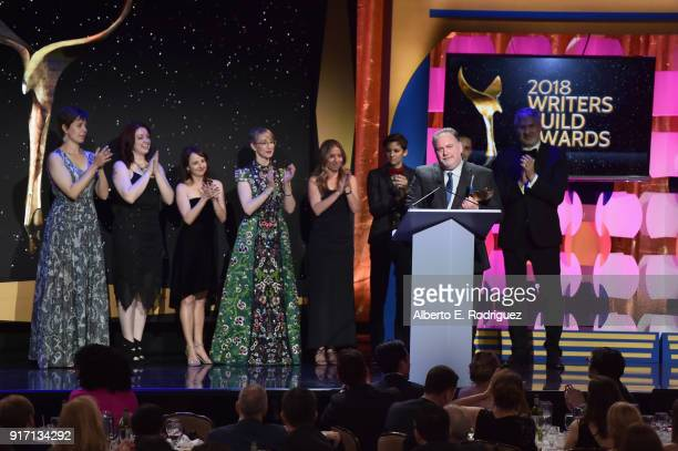 Writer-producer Bruce Miller and the writers of 'The Handmaid's Tale' accept the Drama Series award onstage during the 2018 Writers Guild Awards L.A....
