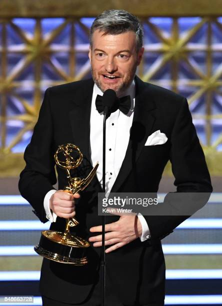 Writer/producer Charlie Brooker accepts Outstanding Writing for a Limited Series Movie or Dramatic Special for 'Black Mirror' onstage during the 69th...