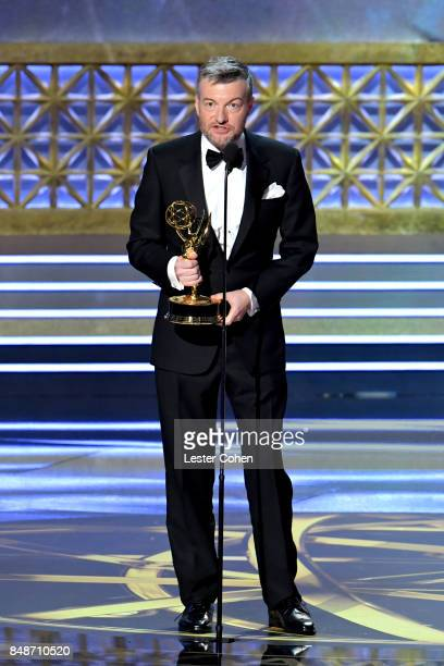 Writerproducer Charlie Brooker accepts the Outstanding Television Movie award for 'Black Mirror' onstage during the 69th Annual Primetime Emmy Awards...