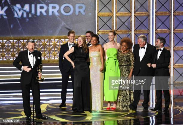 Writer/producer Charlie Brooker with cast and crew accept Outstanding Television Movie for 'Black Mirror' onstage during the 69th Annual Primetime...