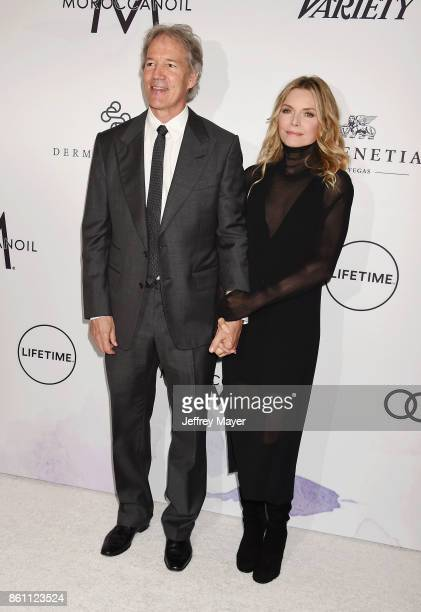 Writer/producer David E Kelley and honoree/actress Michelle Pfeiffer arrives at the Variety's Power Of Women Los Angeles at the Beverly Wilshire Four...