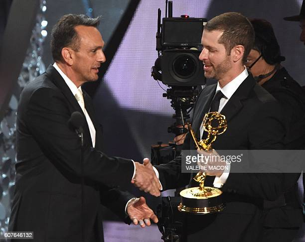 Writer/producer DB Weiss accepts Outstanding Writing for a Drama Series for 'Game of Thrones' episode 'Battle of the Bastards' from actor Hank Azaria...
