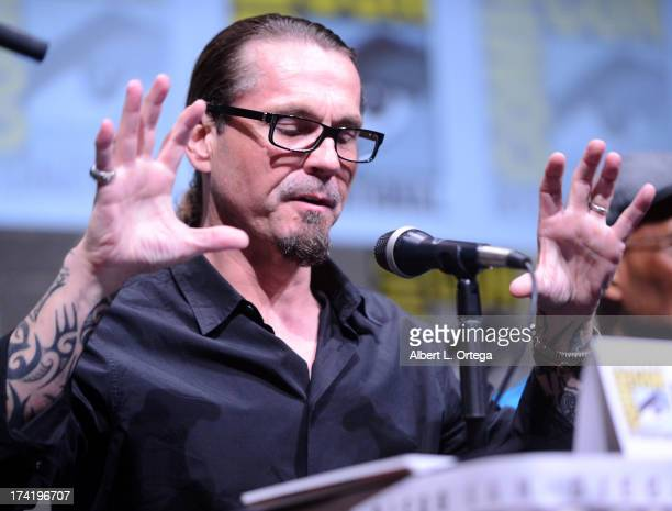Writer/producer Kurt Sutter speaks onstage at the 'Sons Of Anarchy' panel during ComicCon International 2013 at San Diego Convention Center on July...