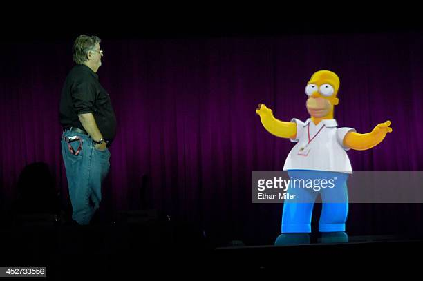 Writer/producer Matt Groening interacts with a projection of Homer Simpson during FOX's 'The Simpsons' panel during ComicCon International 2014 at...
