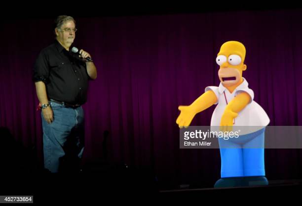 Writer/producer Matt Groening interacts with a projection of Homer Simpson during FOX's The Simpsons panel during ComicCon International 2014 at the...