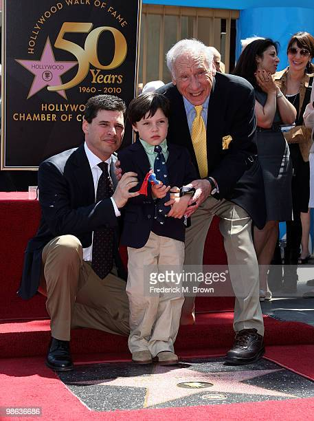 Writer/producer Mel Brooks his sone Max and grandson Henry pose for photographers during the installatiion ceremony honoring him with a star on The...