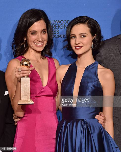 Writer/producer Sarah Treem and actress Julia Goldani Telles winners of the Best Drama Series Award for The Affair pose in the press room during the...