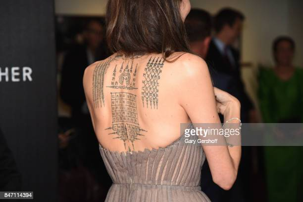 Writer/producer/director Angelina Jolie tattoo deatail attends the First They Killed My Father New York premiere on September 14 2017 in New York City