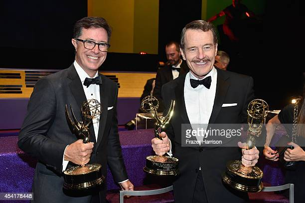 Writer/Producer/Host Stephen Colbert , winner of the for Outstanding Variety Series Award for The Colbert Report and actor Bryan Cranston, winner of...