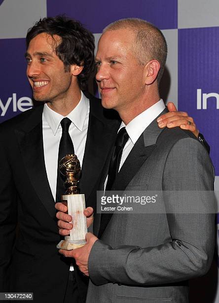 Writerproducers Brad Falchuk and Ryan Murphy attend the InStyle and Warner Bros 67th Annual Golden Globes post party held at the Oasis Courtyard at...