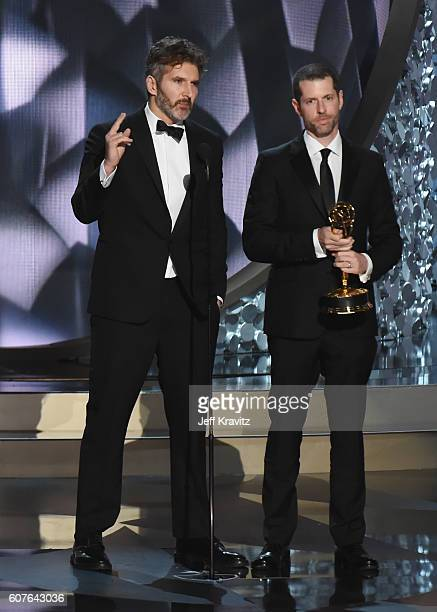 Writer/producers David Benioff and DB Weiss accept the award for Outstanding Writing for a Drama Series for 'Game of Thrones' episode 'Battle of the...