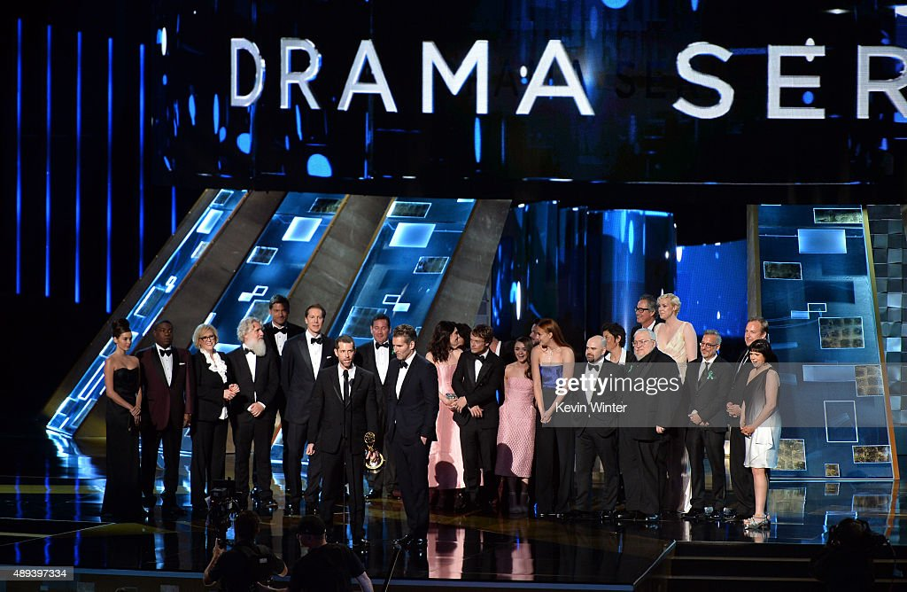 Writer/producers David Benioff and D.B. Weiss (at mic) with cast and crew accept Outstanding Drama Series award for 'Game of Thrones' onstage during the 67th Annual Primetime Emmy Awards at Microsoft Theater on September 20, 2015 in Los Angeles, California.