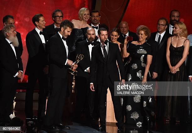 Writer/producers David Benioff and DB Weiss with cast and crew accept the award for Outstanding Drama Series for 'Game of Thrones' during the 68th...